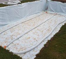 Installation du drain sous dalle de piscine En attente du gravier 20/40