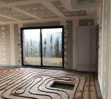 07/02/2019 : Pose de l'isolant de sol & du plancher chauffant- Pièce à vivre