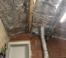Isolation toiture du garage Mise en place d'un isolant mince.