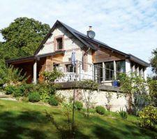 Bardage bois et maison pierre