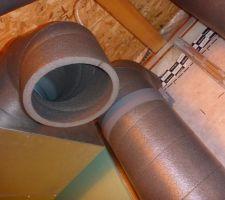 Installation des tuyaux sur les caissons de répartition