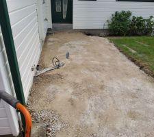 Mise a niveau du calcaire pour trottoir en gres