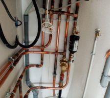 Installation chaudière à gaz et branchement du réseau d eau.