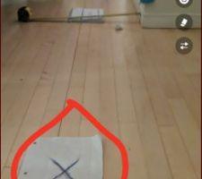 Le x se trouve a etre un poteau fait en 2x4 au sous sol qui tien la poutre voir autre photo pour le poteau en question
