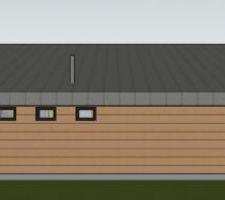 La façade nord, avec le moins d'ouverture possible.  De gauche à droite : fenêtre douche, fenêtre WC, fenêtre local technique. On aperçois la fumisterie, je sais pas si c'est bon pour le tirage; un emplacement en bas de pente.