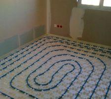Chauffage au sol d'une chambre