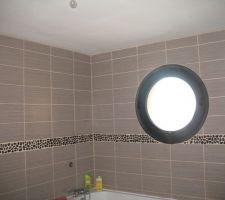 Oeil de boeuf de la salle de bain