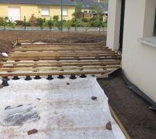 pose des lambourdes sur terrasse existante en beton